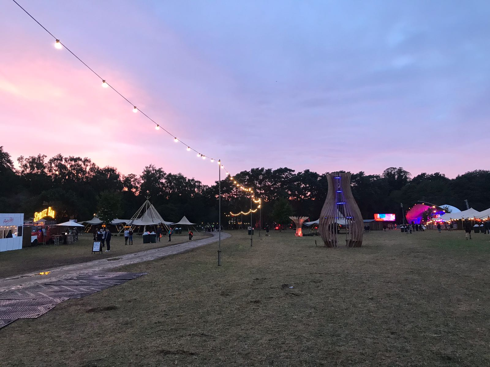 The sun rises over the entrance to the Houghton Festival arena. Image: Tom Jenkins