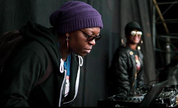 Producer Coco on the decks as part of a Ujima Radio stage takeover. Photo: Ujima Archives