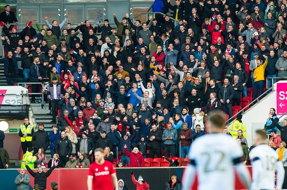 Fans celebrate during Bristol City's home win against Luton Town.