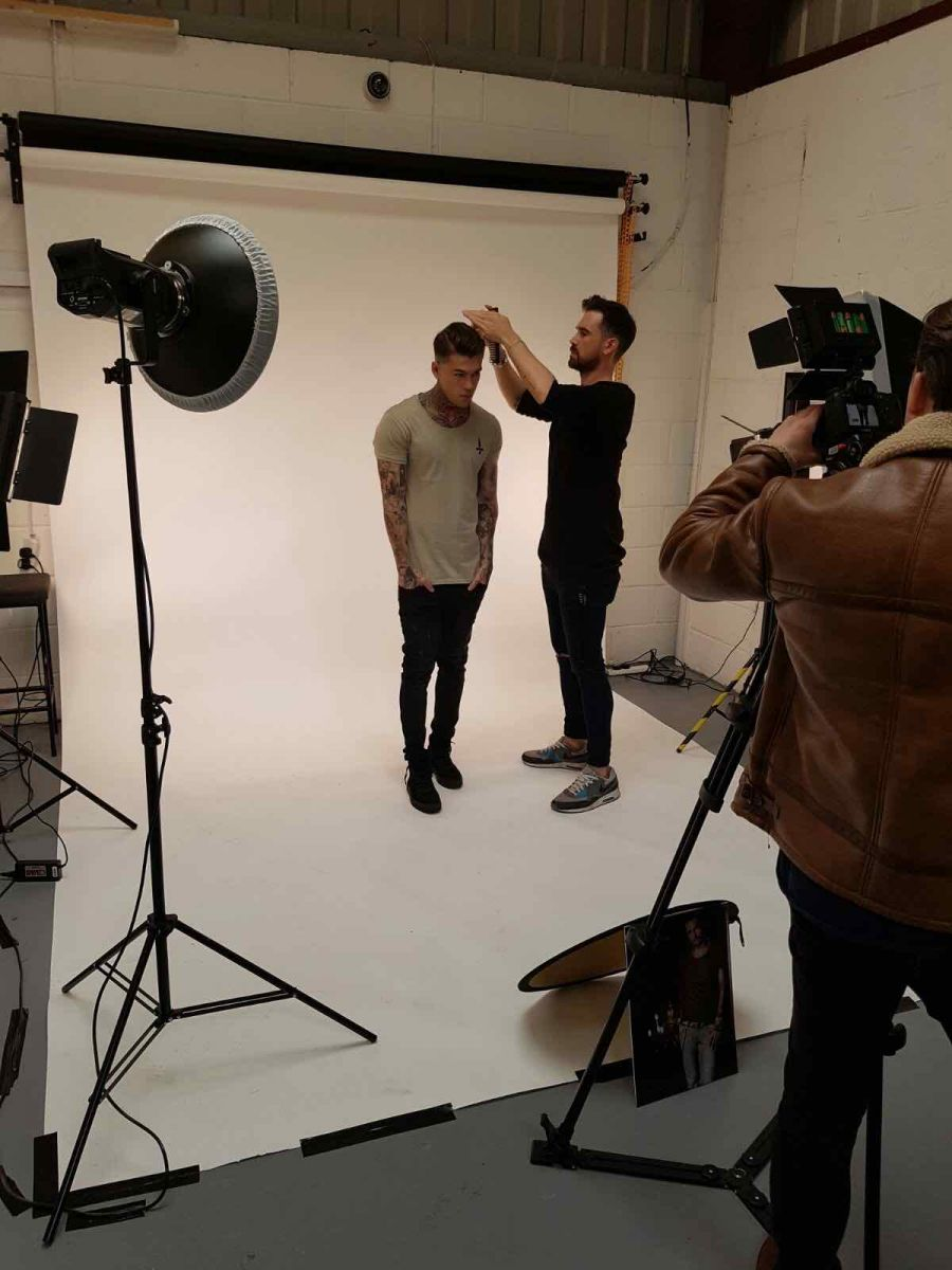Model Stephen James getting a helping hand to look great during a photoshoot